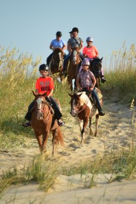 Headed through the dunes onto the beach.  Photo by Equine Adventures.